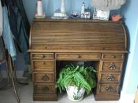 A lovely solid wood roll top desk made in the early