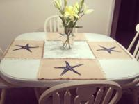Adorable, freshly repainted table and chairs. Sea blue