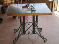 Heavy table with solid wrought iron legs. From Sedona