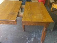 A great Antique wood table with 3 leaves on wheels