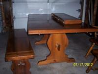 this is a great solid wood table it measures 70 inches