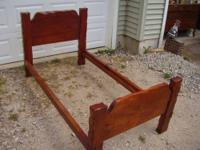 This is a solid wood twin bed set. Consists of head