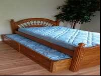 Beautiful solid wood Captains Twin Bed with roll out
