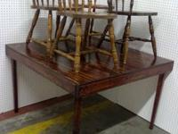 For sale is a solid wood walnut discolored table & 4
