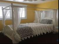 Twin size bed with canopy top by Stanley Furniture.