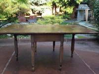 When fully extended, this antique drop leaf table is 66