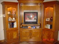 Solid oak entertainment center. It has 3 sections with