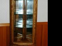 This Is a Solid Oak Corner Curio Cabinet with 5 rounded