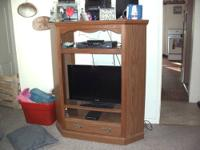 Nice solid oak entertainment center. Has 3 adjustable