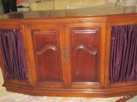 This is a beautiful solid, heavy Pecan wood cabinet in