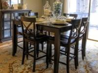 Solid wood counter height dining table in black finish,