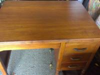 solid wood desk I believe mohagony, very nice, small