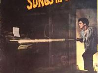 This is the vinyl LP album of Songs In The Attic by