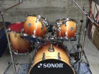Sonor full maple five piece drum set in autumn maple