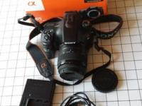 For sale is Sony a65 24.3 megapixel DSLR kit, the