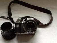 Sony DSC-H1 Cyber Shot camera. Includes bag and user's