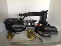 Sony NEX-FS100UK camera with lense, shotgun mic,