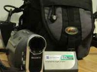 Sony handycam DCR-HC38, with charger and AV cable.