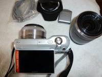 Sony NEX-3 interchangeable lens camera with 2 lenses