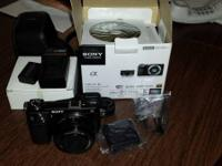 Sony NEX-6 mirror less camera with 16-50mm len.  Comes