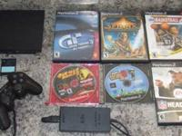 Up for sale is a PS2 system with 1 memory card, 2
