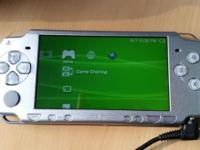 Sony PSP 2000, silver, comes with charger, 2gig card,