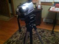 Good Condition comes with a Tripod, Battery Packs,