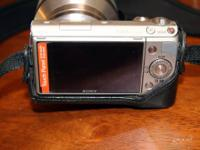 NEX-5n, silver body, with SEL18200 lens - $750 w/black
