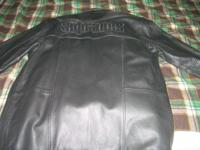 Sopranos long leather coat with removable liner. Never