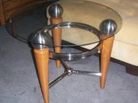 cool retro style end table with a glass top, wood legs,