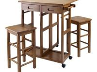 Space-saving dining table with two stools in teak