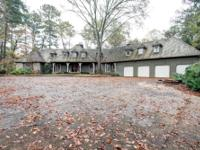 Spacious builder's home on 3.15 acres and a lake, has