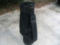 A black Spalding golf bag in very good condition. Cash