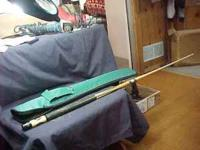 "I have a very nice Spalding Pool Cue 57"" 2 pc with case"