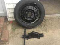 Spare tire, rim, and jack for sale. Five lugnut