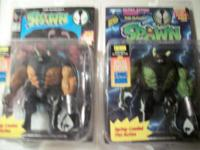 A BUNCH OF SPAWN ACTION FIGURES WITH THE COMIC BOOKS