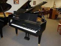 This is a gorgeous Baldwin grand piano, model R, 1993.