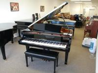 This is a stunning Yamaha grand piano, model C2, high
