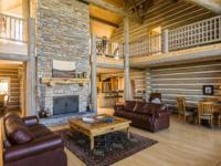 This unique custom log home is meticulously maintained