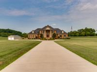 This one of a kind spectacular luxury estate offers all