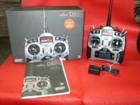 I have for sale two Spektrum Dx6i R/C transmitters.