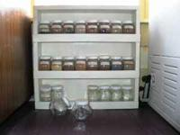 Custom made spice rack holder with 24 spice jars. Each