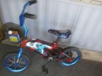 Spiderman bike has training wheels to go with it small