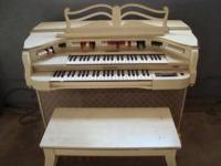 White spinet organ and bench. Moving and must sell.