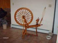 Beautiful handmade Jensen cherry wood spinning wheel