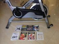 I have a ligthly used spinning bike whit execise dvd