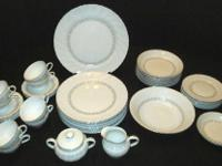 These dishes are white with a swirl border, a silver or