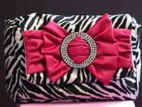 I'm selling a Spoiled Little Mama Zebra diaper bag with
