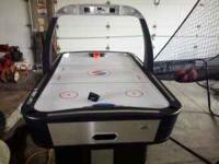 Almost brand new air hockey table. It has been hardly