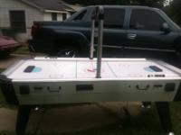 Gently used 7 foot Air Powered Air Hockey table by